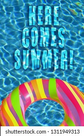 "Summertime/ Vacation concept. Colorful pool float in swimming pool. ""Here Comes Summer"""
