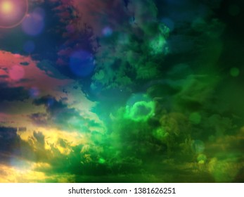 Summery sky background in blue, green and pink hues.