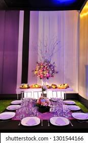 Summery table centrepieces at a lavish garden wedding ceremony.