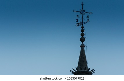 Summit of a church tower on a cold afternoon in Spain.