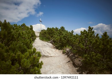 Summit cross at Herzogstand mountain in Bavaria, Germany in summertime