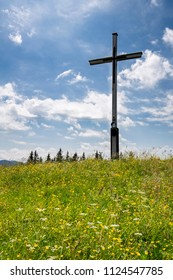 Summit cross at the Rechelkopf mountain in Bavaria, Germany