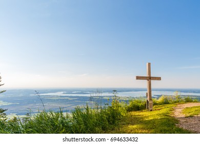 Summit Cross at Schnappenkirche Staudach Egerndach in Bavaria Germany with view to lake Chiemsee