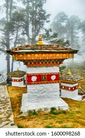 Summit is marked by 108 Buddhist shrines in misty winter morning, Dochula Pass, Bhutan
