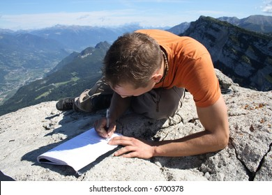 At the summit of a mountain - writing in the summit book
