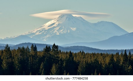 Summit of Mt. Shasta in California covered with clouds