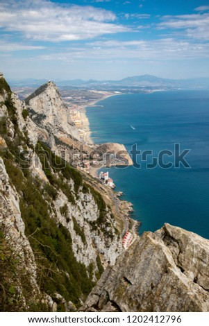 The summit of the Rock of Gibraltar looking North towards Spain . Gibraltar is a British Overseas Territory located on the southern tip of Spain.