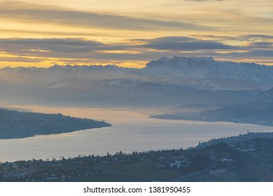 Summit of Uetliberg mountain in early morning with cloudy atmosphere and morning fog. Top of Zurich, Switzerland. The lake view and Swiss Alps on the background.