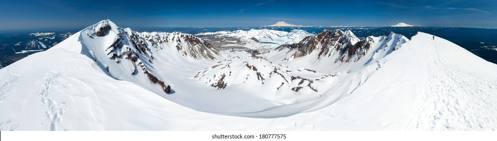 Summit view of the Mount St. Helens caldera. Mount Rainier, Mount Adams, and the Olympic Mountains in view.
