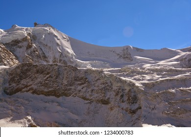 The summit of the Zinalrothorn (left)  with the Arrete du Blanc knife edge ridge (centre)
