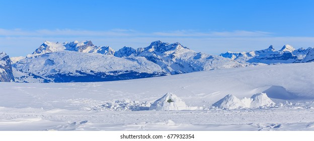 Summits of Alps in Switzerland, wintertime view from the Fronalpstock mountain in the Swiss canton of Schwyz.