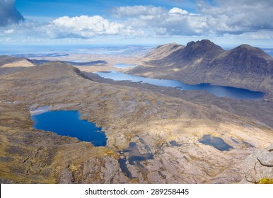 Summits of Baosbheinn and Loch a Bhealaich (right) and summits of Beinn Bhreac,Creag a Chinn Duibh (middle left) with Loch Toll nam Biast lower left.