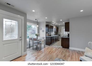 Sumner, WA / USA - Oct. 25, 2018: Modern living room, dining room and kitchen interior