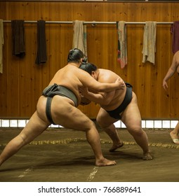 Sumo wrestler fighters dressed in traditional sumo outfit train in sumo stables preparing for sumo tournament championship held in Tokyo Japan