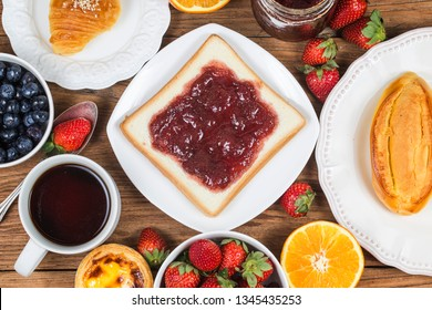 A sumptuous breakfast, strawberry jam toast,