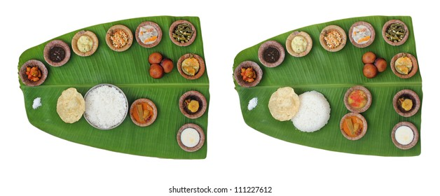 Sumptuous and wholesome onam meals called sadhya in kerala. The lunch contains varieties of curries and vegetable mixes along with papad, sweet appam and kheer. The food is served on a banana leaf