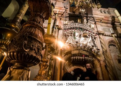 The sumptuousness of interior and of burning candles of the Church of Holy Sepulchre, Jerusalem, Israel: October 24, 2018