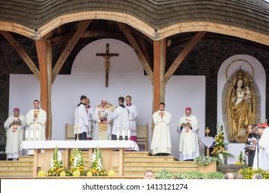 Sumuleu Ciuc, Romania - June 1, 2019:  Catholic pilgrims, crowd of people gathering in Csiksomlyo to celebrate the Pope Francis' Mass. Pope Francis in Romania, 2019.
