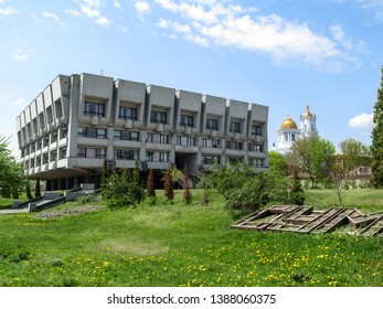 Sumy, Ukraine - April 28, 2019: Sumy Oblast Universal Scientific Library named after Nadezhda Krupskaya and Savior-Transfiguration Cathedral in the background. Beautiful cityscape with city sights