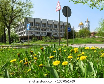 Sumy, Ukraine - April 28, 2019: Signs of the bike path and pedestrian crossing near Sumy Oblast Scientific Library named Krupskaya. Spring cityscape against the Savior-Transfiguration Cathedral
