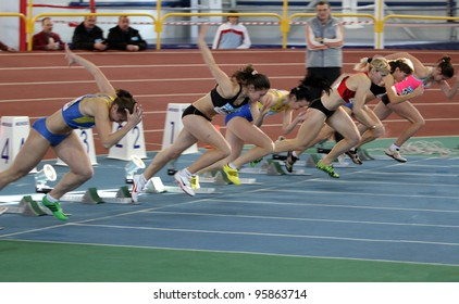 SUMY, UKRAINE - FEB.17: Unidentified girls on the start of the 60 meters dash during the Ukainian Track and Field Championships on February 17, 2012 in Sumy, Ukraine.