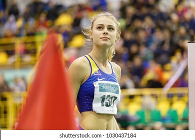 SUMY, UKRAINE - FEBRUARY 10, 2018: Yuliya Levchenko - winner of high jump competition on Ukrainian indoor track and field championship 2018 after her unsuccessful attempt.