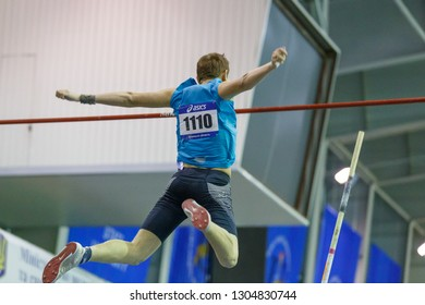 SUMY, UKRAINE - JANUARY 25, 2019: athlete performing his attempt in pole vault competition on Team Ukrainian indoor track and field championship 2019.