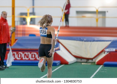 SUMY, UKRAINE - JANUARY 25, 2019: young female athlete performing her attempt in pole vault competition on Team Ukrainian indoor track and field championship 2019.