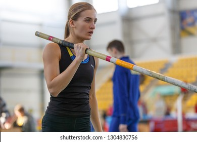 SUMY, UKRAINE - JANUARY 25, 2019: Yuliya Maksymenko - winner of contest performing her attempt in pole vault competition on Team Ukrainian indoor track and field championship 2019.