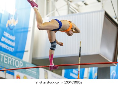 SUMY, UKRAINE - JANUARY 25, 2019: Yana Hladiychuk performing her attempt in pole vault competition on Team Ukrainian indoor track and field championship 2019.