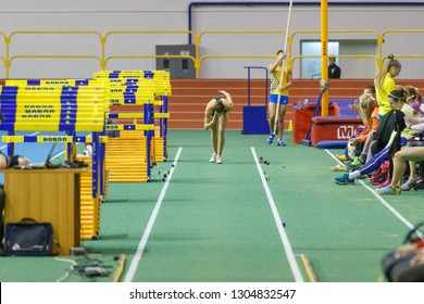 SUMY, UKRAINE - JANUARY 25, 2019: Maryna Bekh - winner in contest, performing her attempt in long jump competition on Team Ukrainian indoor track and field championship 2019.