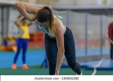 SUMY, UKRAINE - JANUARY 25, 2019: Iryna Beketova - winner of contest performing her shot put attempt in pentathlone competition on Team Ukrainian indoor track and field championship 2019.