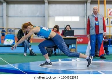 SUMY, UKRAINE - JANUARY 25, 2019: Hanna Nelepa performing her shot put attempt in pentathlone competition on Team Ukrainian indoor track and field championship 2019.