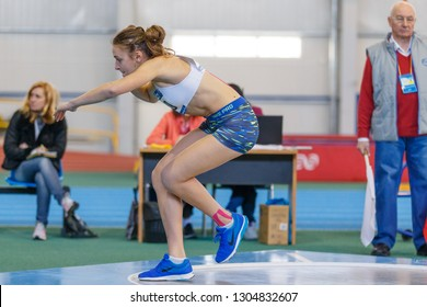 SUMY, UKRAINE - JANUARY 25, 2019: Kateryna Shastun performing her shot put attempt in pentathlone competition on Team Ukrainian indoor track and field championship 2019.