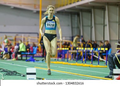 SUMY, UKRAINE - JANUARY 25, 2019: Anna Krasutska run out in her attempt in long jump competition on Team Ukrainian indoor track and field championship 2019.
