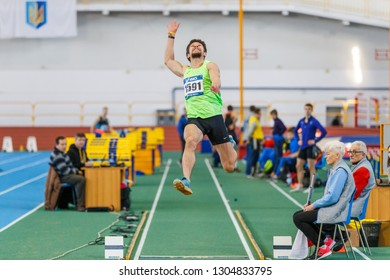 SUMY, UKRAINE - JANUARY 25, 2019: Yaroslav Isachenkov - winner of contest, performing his attempt in long jump competition on Team Ukrainian indoor track and field championship 2019.
