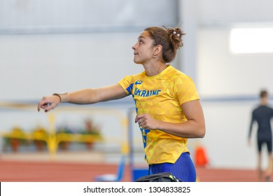 SUMY, UKRAINE - JANUARY 25, 2019: Rimma Buinenko performing her shot put attempt in pentathlone competition on Team Ukrainian indoor track and field championship 2019.
