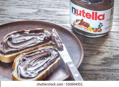 SUMY, UKRAINE - NOV 3, 2016: Nutella hazelnut spread jar. Nutella is a brand of sweetened hazelnut cocoa spread manufactured by the Italian company Ferrero.