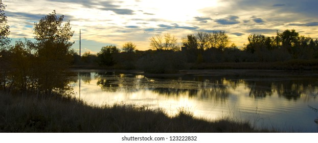 Sun is about to rise over a small wetland refuge on the Colorado prairie