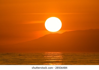 Sun about to set behind island, Large Glowing Sphere