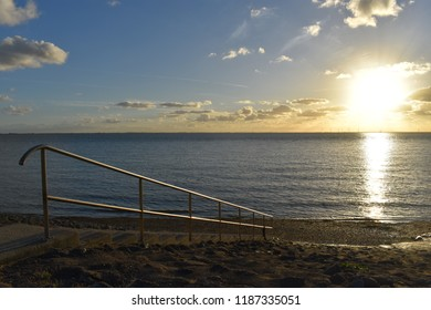 Sun above the Oosterschelde with stairs