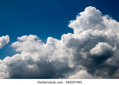 Sun beam with fluffy white clouds