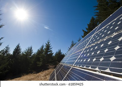 The sun beams down on multiple solar panels along the northern California coast.
