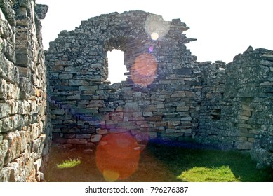 The sun beams into Hvalsey Viking Church, built by Eric the Red's uncle Thorkell Farserkur in the 14th century. Roof has gone but walls are strong and well-preserved. A Viking wedding was held here.