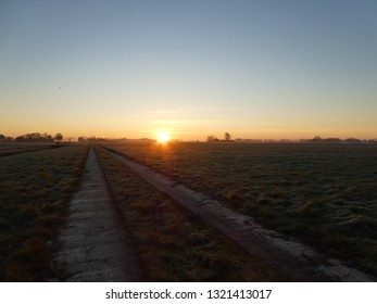 The was to the sun. Beautiful sunrise in the countryside of Groningen