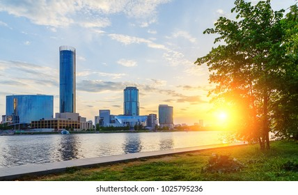 sun and beautiful sunset over the city center and city pond of Yekaterinburg in summer