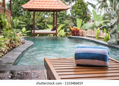 Sun bed at private pool in Bali - Indonesia