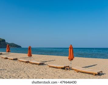 Sun beds on the beach.