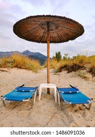 sun beds with umbrellas on the beach