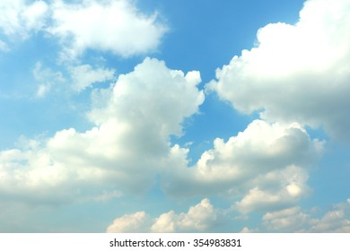 Sun behind the clouds background beautiful blue sky with white clouds